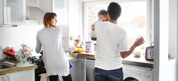 Family of three in the kitchen